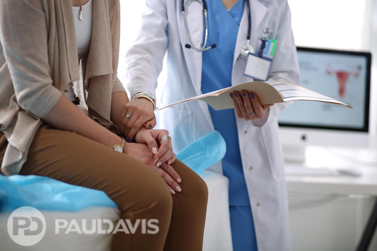 Healthcare worker comforting patient