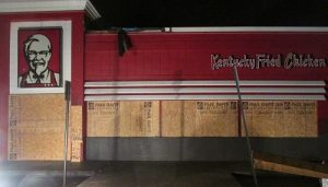 Emergency services include boarding up windows before storms.