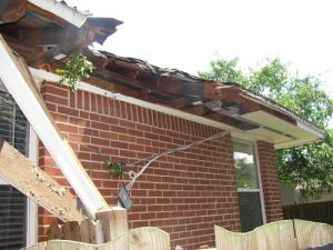 Wind and storm damage in Jacksonville before repairs.