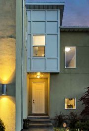 Tan house with golden exterior lights
