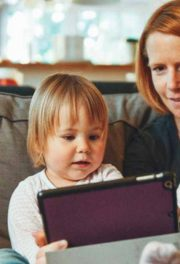 Woman and two children looking at tablet