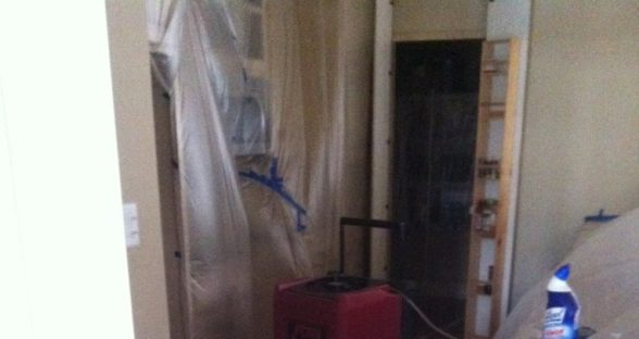 Water damage to a wood floor being repaired by Paul Davis