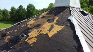 stripping a church roof to allow mold removal services