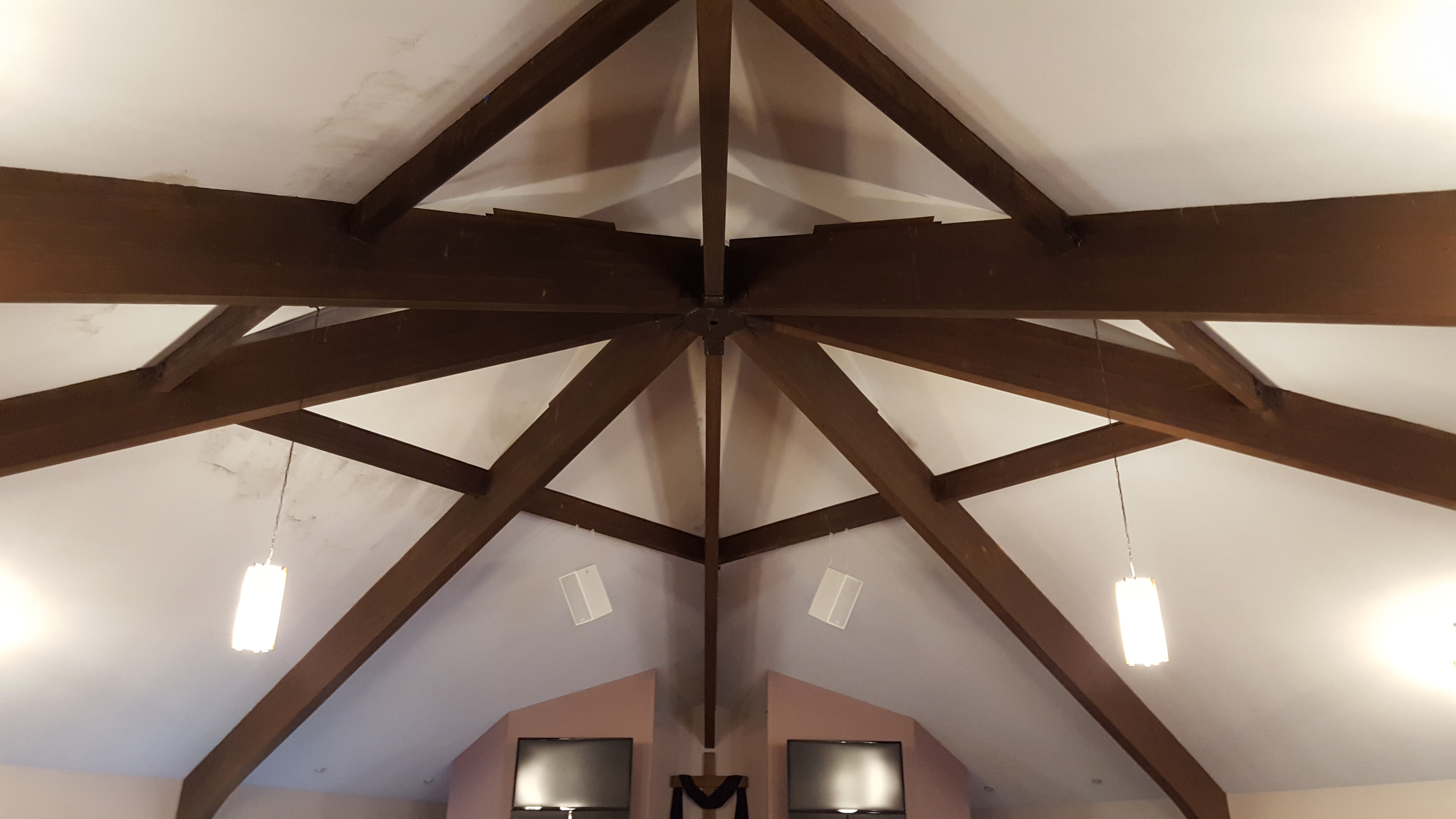 mold removal required along ceiling beams of a church