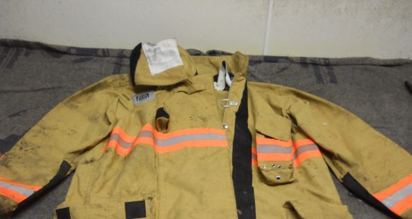 jacket with tar before cleaning