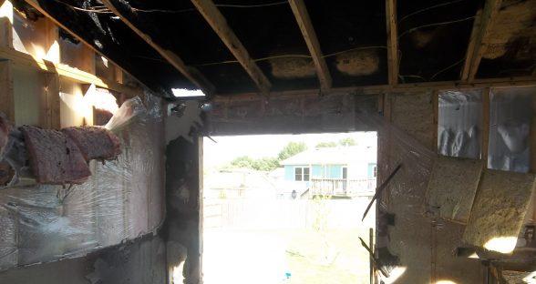 Patio door interior with fire damage